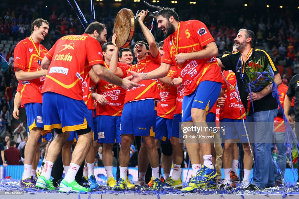 Joan Canellas and Jorge Maqueda of Spain celebrate on the podium after winning the Men's Handball World Championship 2013 final match between Spain and Denmark at Palau Sant Jordi on January 27, 2013 in Barcelona, Spain.