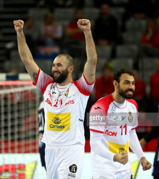 Joan Canellas of Spain adn team mate Daniel Sarmiento celebrate during the Men's Handball European Championship semi final match between France and...