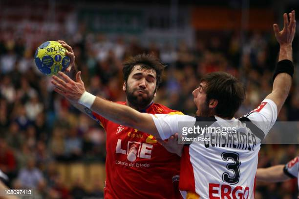 Joan Canellas of Spain is challenged by Uwe Gensheimer of Germany during the Men's Handball World Championship Group A match between Spain and...