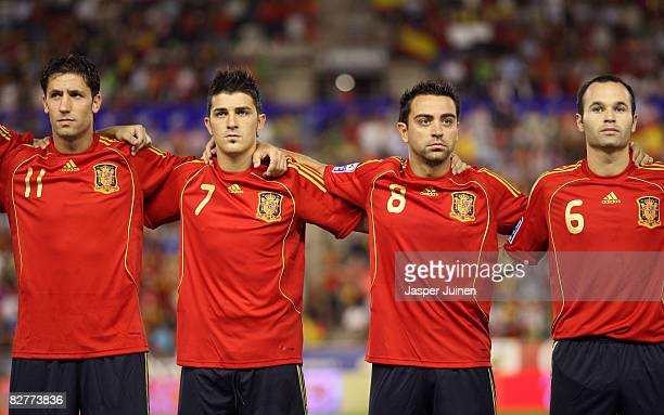 Joan Capdevila, David Villa, Xavier Hernandez and Andres Iniesta listen to their countries national anthoms prior to the FIFA2010 World Cup Qualifier...