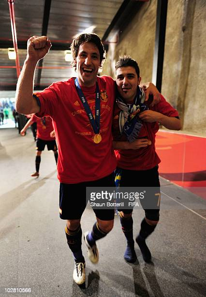 Joan Capdevila of Spain and David Villa celebrate after the 2010 FIFA World Cup South Africa Final match between Netherlands and Spain at Soccer City...