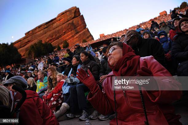 Joan Colby Wilson of Denver Colorado claps along to gospel music during the sixtythird annual Easter Sunrise Service at Red Rocks Amphitheatre on...