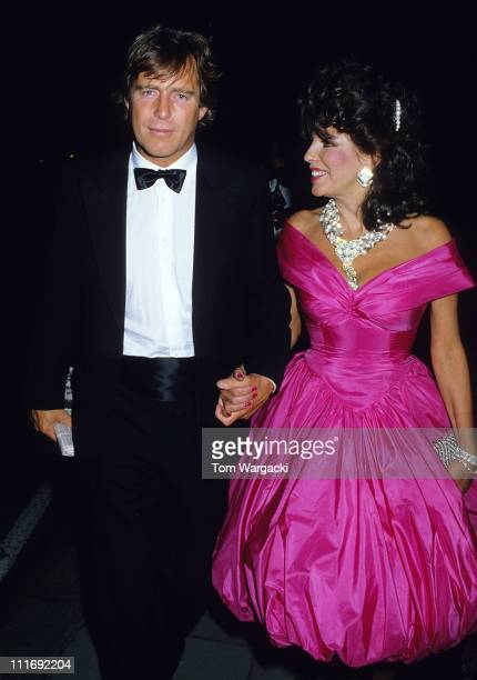 Joan Collins and boyfriend Bill Wiggins during 'The Living Daylights' London Premiere After Party at Annabels in London Great Britain