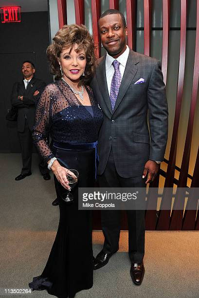 Joan Collins and Chris Tucker attend The Film Society of Lincoln Center's presentation of the 38th Annual Chaplin Award at Alice Tully Hall on May 2,...
