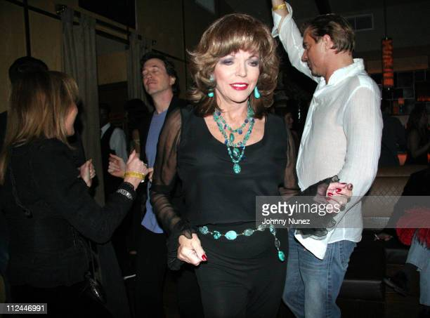 Joan Collins and Jack Rich during Jack Rich's Birthday Party November 5 2005 at Marquee in New York City New York United States