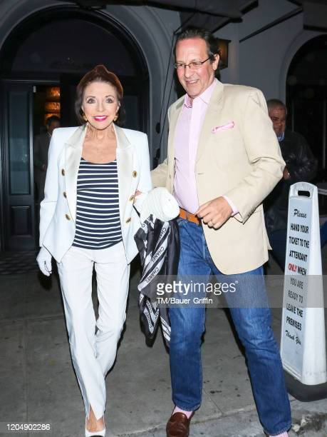 Joan Collins and Percy Gibson are seen on March 02 2020 in Los Angeles California