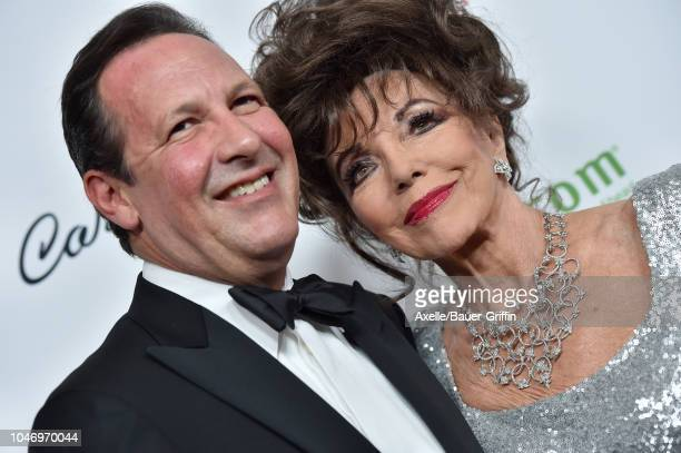Joan Collins and Percy Gibson attend the 2018 Carousel of Hope Ball at The Beverly Hilton Hotel on October 6 2018 in Beverly Hills California