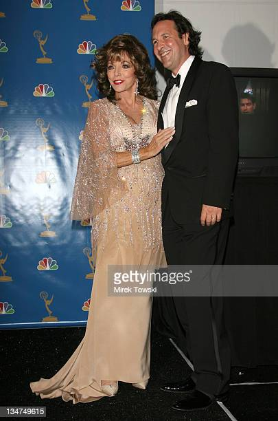 Joan Collins and Percy Gibson during 58th Annual Primetime Emmy Awards Press Room at Shrine Auditorium in Los Angeles California United States
