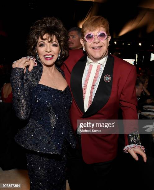 Joan Collins and Sir Elton John attend the 26th annual Elton John AIDS Foundation Academy Awards Viewing Party sponsored by Bulgari celebrating EJAF...