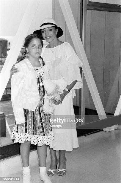 Joan Collins at LAP with her daughter Katy after a holiday in the South of France 19th July 1983