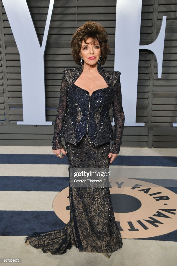 Joan Collins attends the 2018 Vanity Fair Oscar Party hosted by Radhika Jones at Wallis Annenberg Center for the Performing Arts on March 4, 2018 in Beverly Hills, California.