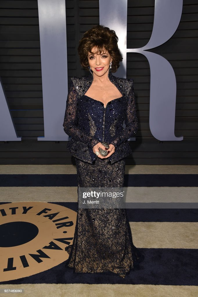 Joan Collins attends the 2018 Vanity Fair Oscar Party hosted by Radhika Jones at the Wallis Annenberg Center for the Performing Arts on March 4, 2018 in Beverly Hills, California.