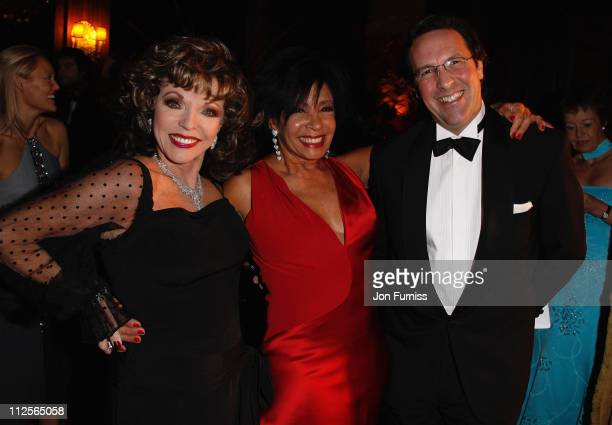 Joan Collins Dame Shirley Bassey and Percy Gibson attend Christmas party in honour of Dame Shirley Bassey to celebrate her 70th Birthday kindly...