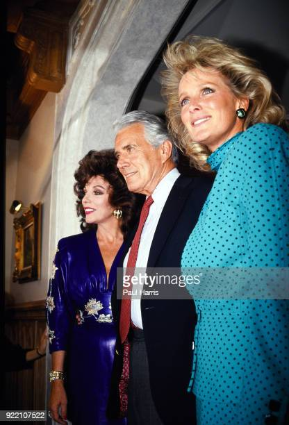 Joan Collins John Forsythe and Linda Evans at a party celebrating the production of 150 episodes of Dynasty in 1986 the party was held on 'The...