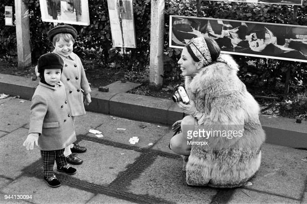 Joan Collins on the set of her new film 'Subterfuge' with her children Sacha and Tara Newley 4th February 1968