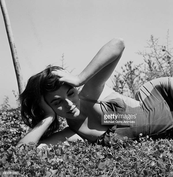 Joan Collins poses at home by the pool in Los Angeles California