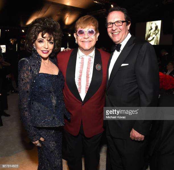 Joan Collins Sir Elton John and Percy Gibson attend the 26th annual Elton John AIDS Foundation Academy Awards Viewing Party sponsored by Bulgari...