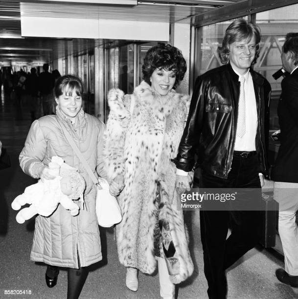 Joan Collins with daughter Katyana Kass and boyfriend Peter Holm at Heathrow after arriving from Los Angeles 22nd December 1983