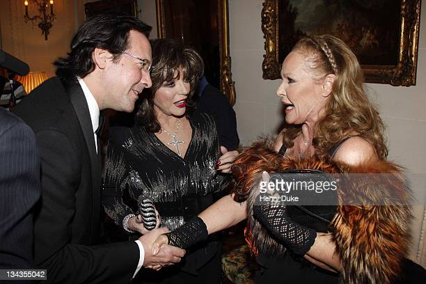 Joan Collins with her husband and Ursula Andress attend the Best Awards 2007 at the Bristol Hotel December 9 2007 in Paris France