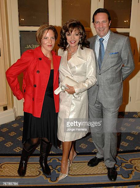 Joan Collins with her husband Percy Gibson and her daughter Katy Kass attend the Julien Macdonald show during London Fashion Week on September 16...