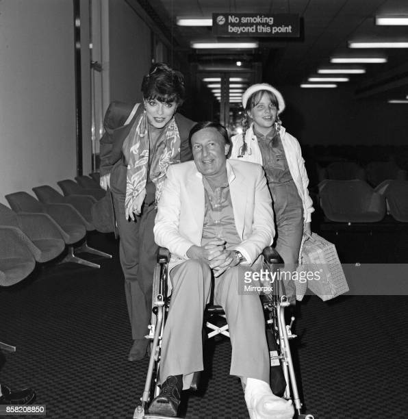 Joan Collins with husband Ron Kass and daughter Katyana arriving at Heathrow from Los Angeles 3rd November 1982