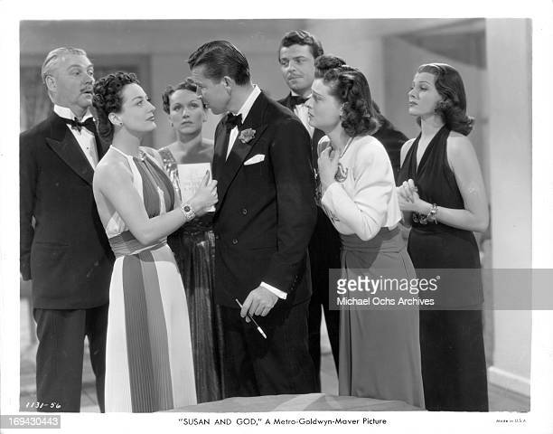 Joan Crawford and Bruce Cabot have the attention of Nigel Bruce Rose Hobart John Carroll Ruth Hussey and Rita Hayworth in a scene from the film...