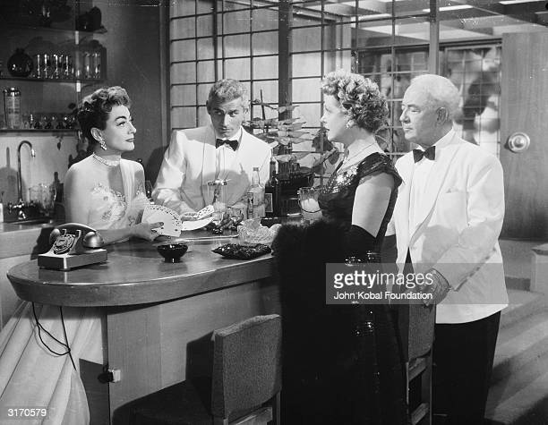 Joan Crawford and Jeff Chandler seem suspicious as they participate in a card game with a couple of elderly swindlers played by Natalie Schafer and...