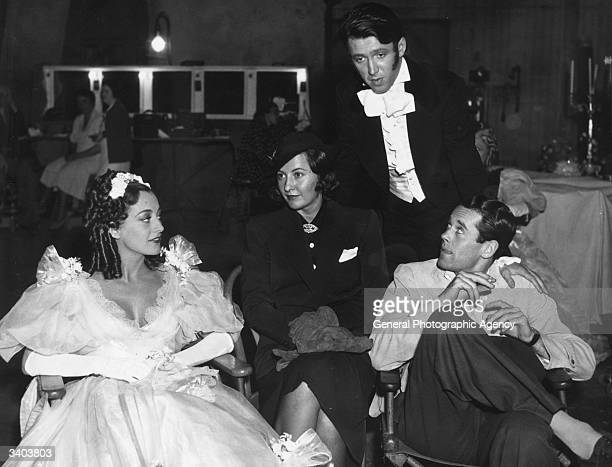 Joan Crawford Barbara Stanwyck Henry Fonda and James Stewart during filming of 'The Gorgeous Hussy' based on the love life of Peggy O'Neal the...