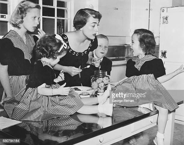 Joan Crawford has four adopted children Christina twins Cathy and Cindy and Christopher