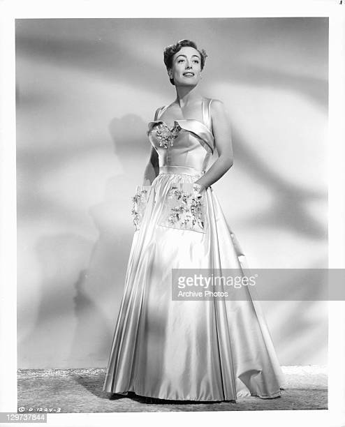 Joan Crawford in formal gown in a scene from the film 'Harriet Craig' 1950