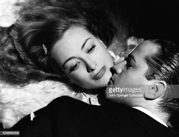 Joan Crawford plays Jessica Cassidy and Alan Curtis plays Eddie Miller in the 1937 film Mannequin