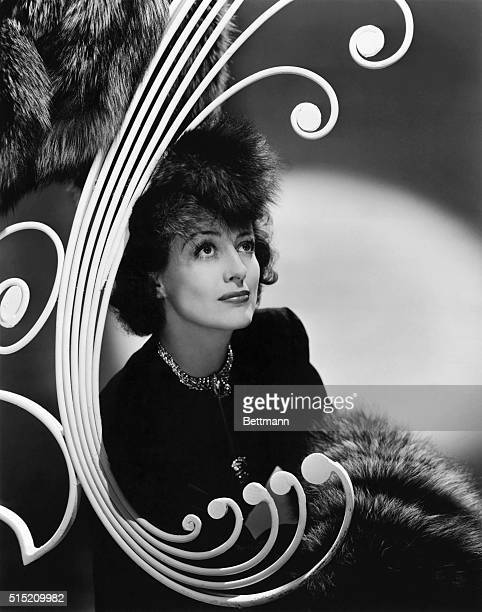 """Joan Crawford, the MGM star is seen in her newest portrait pose, in decided contrast to her role as Julie, the cafe entertainer in """"Strange Cargo,""""..."""