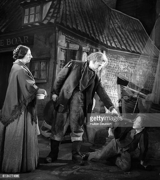 Joan Cross Peter Pears and Leonard Thompson in a scene from Benjamin Britten's new opera Peter Grimes at Sadler's Wells