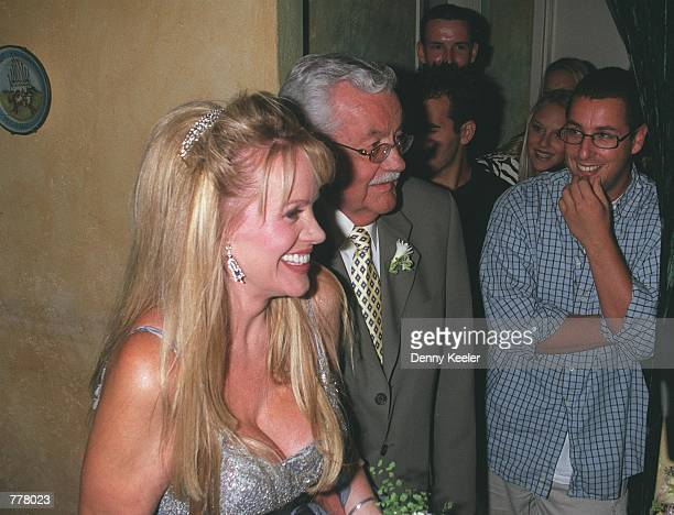 Joan Dangerfield walks down the aisle with her father while Adam Sandler right looks on at Largo's Restaurant August 28 2000 in Santa Monica CA The...