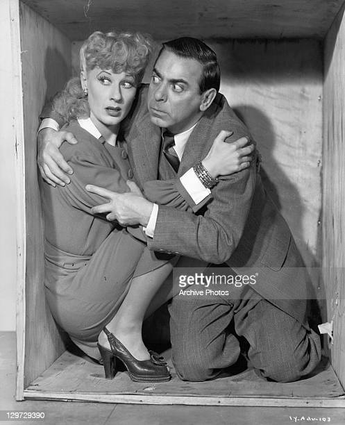 Joan Davis and Eddie Cantor hold each other inside a wooden box in a scene from the film 'If You Knew Susie' 1948