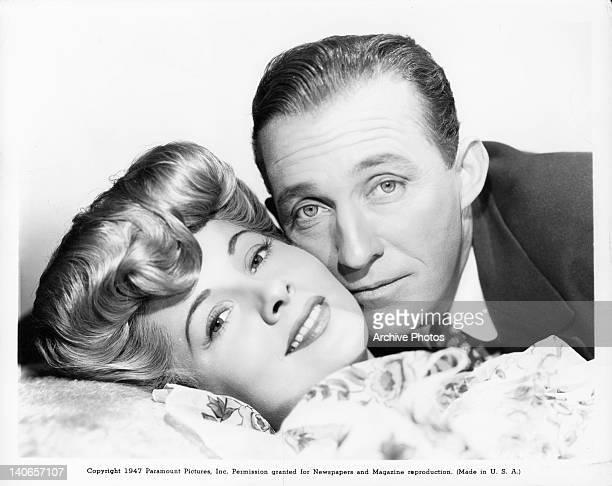 Joan Fontaine and Bing Crosby cheek to cheek in a scene from the film 'The Emperor Waltz' 1948