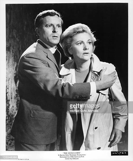 Joan Fontaine is held by unidentified man in a scene from the film 'The Devil's Own' 1966