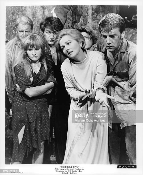 Joan Fontaine suffering among unidentified actors in a scene from the film 'The Devil's Own' 1966