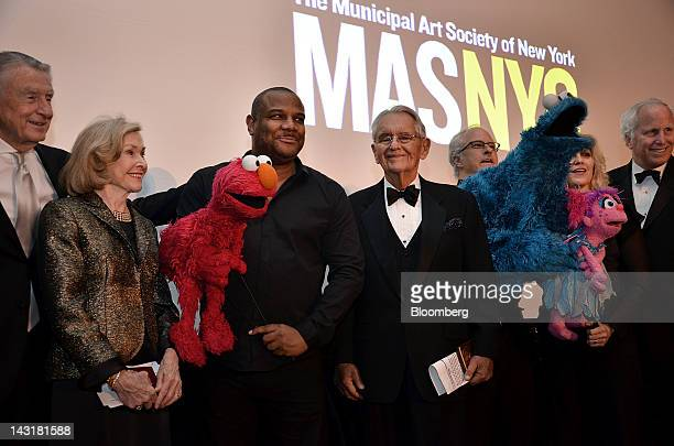 Joan Ganz Cooney former chief executive officer of Sesame Workshop from second left Kevin Clash coexecutive producer of Sesame Street and Elmo...