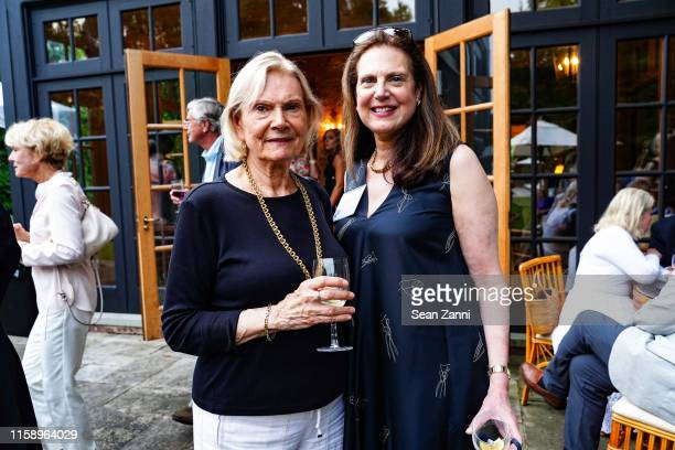 Joan Grace and Andrea Hart attend A Country House Gathering To Benefit Preservation Long Island on June 28 2019 in Locust Valley New York