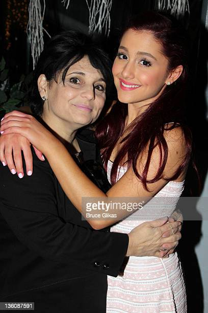 Joan Grande and daughter Ariana Grande pose at Planet Hollywood Times Square on December 22 2011 in New York City