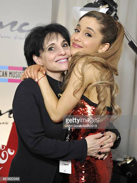 Joan Grande and singer Ariana Grande pose in the Music Choice Lounge backstage at the 2013 American Music Awards at Nokia Theatre LA Live on November...