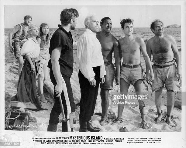 Joan Greenwood Beth Rogan Michael Craig Herbert Lom Michael Callan and Gary Merrill looking up in a scene from the film 'Mysterious Island' 1961