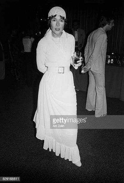 Joan Hackett holding a drink at a formal event circa 1970 New York