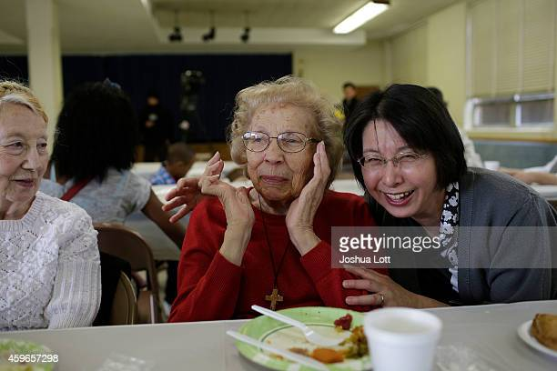 Joan Hahn watches as Jane Nishawaki and her daughterinlaw Noriko Utsunomiya laugh while eating their Thanksgiving lunch at Wellspring Church November...