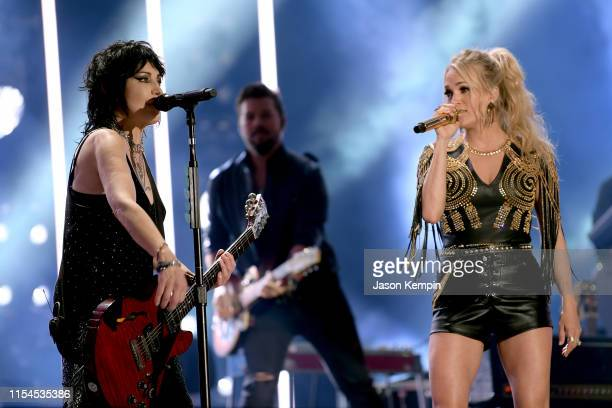 Joan Jett and Carrie Underwood perform on stage during day 2 for the 2019 CMA Music Festival on June 07 2019 in Nashville Tennessee