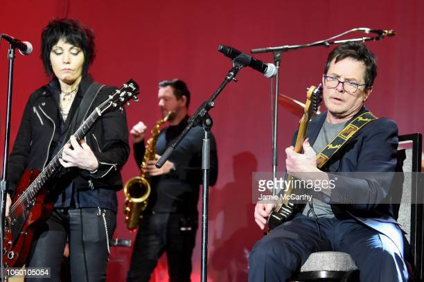 Joan Jett and Michael J Fox perform on stage at A Funny Thing Happened On The Way To Cure Parkinson's benefitting The Michael J Fox Foundation at the...