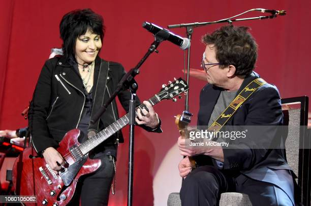 Joan Jett and Michael J. Fox perform on stage at A Funny Thing Happened On The Way To Cure Parkinson's benefitting The Michael J. Fox Foundation at...