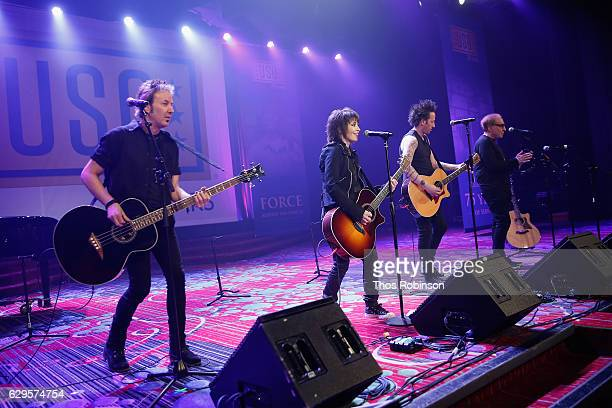 Joan Jett and the Blackhearts perform onstage during the USO 75th Anniversary Armed Forces Gala Gold Medal Dinner at Marriott Marquis Times Square on...