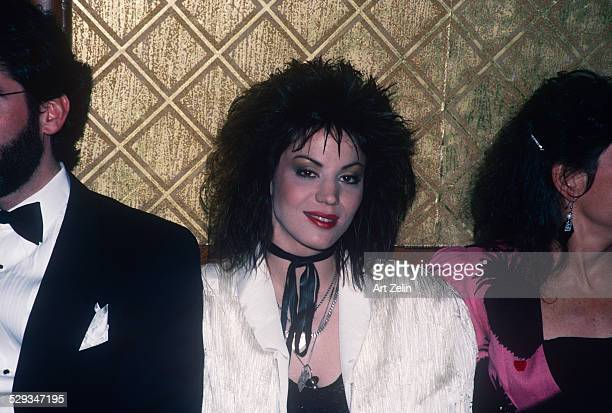 Joan Jett at a formal event wearing a white jacket; circa 1970; New York.